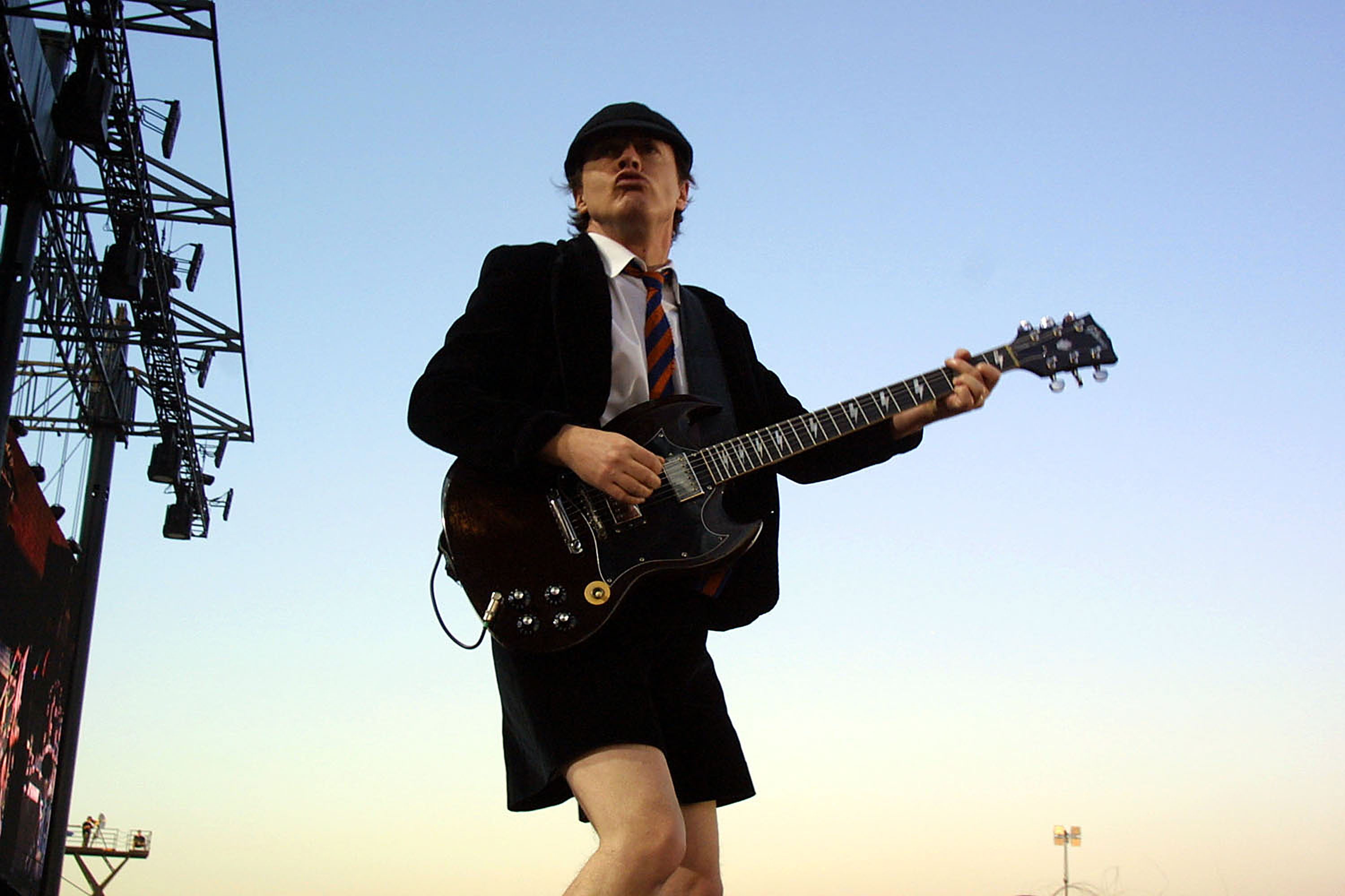 TORONTO, CANADA - JULY 30:  Angus Young of the Australian rock group AC/DC performs during the SARS relief concert held at Downsview Park July 30, 2003 in Toronto, Canada. An estimated 490,000 fans showed up for the daylong music festival headed by the Rolling Stones.  (Photo by Donald Weber/Getty Images)
