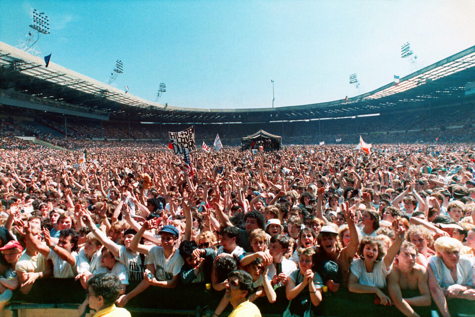 A huge crowd attends the Live Aid famine relief concert for Africa at Wembley Stadium.